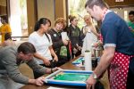 10-Student-Services-staff-help-silk-screen-a-green-message-onto-peoples-used-t-shirts.jpg