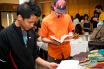 12-Students-perused-used-book-trade-at-the-Green-Fair.jpg